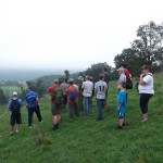 Hikers enjoy the view from Headquarters Hill where Gen. Averell watched the battle in 1863.