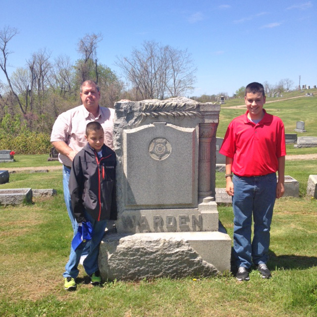 Tom Gross and sons visit ancestor's grave